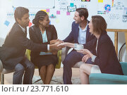 Купить «Group of businesspeople shaking hands with each other in front of whiteboard», фото № 23771610, снято 22 мая 2019 г. (c) Wavebreak Media / Фотобанк Лори