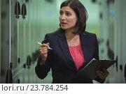 Купить «Technician preparing check list», фото № 23784254, снято 11 июля 2016 г. (c) Wavebreak Media / Фотобанк Лори