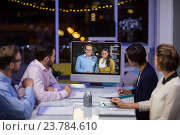 Купить «Business team having video conference», фото № 23784610, снято 2 июня 2016 г. (c) Wavebreak Media / Фотобанк Лори