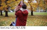 Купить «happy young couple meeting in autumn park», видеоролик № 23787378, снято 12 октября 2016 г. (c) Syda Productions / Фотобанк Лори