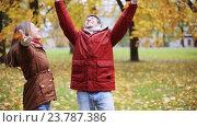 Купить «happy young couple throwing autumn leaves in park», видеоролик № 23787386, снято 12 октября 2016 г. (c) Syda Productions / Фотобанк Лори