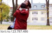 Купить «happy young couple meeting in autumn park», видеоролик № 23787486, снято 12 октября 2016 г. (c) Syda Productions / Фотобанк Лори