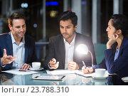 Купить «Group of businesspeople discussing over digital tablet», фото № 23788310, снято 22 мая 2019 г. (c) Wavebreak Media / Фотобанк Лори