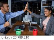 Купить «Business executives giving high fives while working in office», фото № 23789210, снято 2 июня 2016 г. (c) Wavebreak Media / Фотобанк Лори