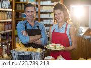 Купить «Portrait of smiling staff standing at bakery counter», фото № 23789218, снято 17 мая 2016 г. (c) Wavebreak Media / Фотобанк Лори