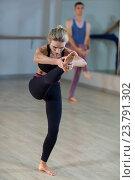 Купить «Woman performing stretching exercise», фото № 23791302, снято 28 апреля 2016 г. (c) Wavebreak Media / Фотобанк Лори