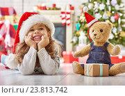 Купить «girl in Santa's hat», фото № 23813742, снято 21 сентября 2015 г. (c) Константин Юганов / Фотобанк Лори