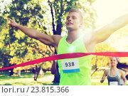 Купить «happy young male runner winning on race finish», фото № 23815366, снято 16 августа 2015 г. (c) Syda Productions / Фотобанк Лори