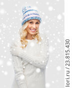 Купить «smiling young woman in winter hat and sweater», фото № 23815430, снято 8 октября 2015 г. (c) Syda Productions / Фотобанк Лори