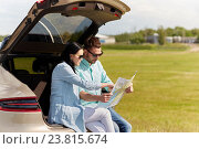 Купить «happy man and woman with road map at hatchback car», фото № 23815674, снято 12 июня 2016 г. (c) Syda Productions / Фотобанк Лори