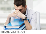 Купить «sad businessman with stack of folders at office», фото № 23815794, снято 18 июня 2015 г. (c) Syda Productions / Фотобанк Лори
