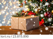 Купить «close up of christmas gift with fir brunch», фото № 23815890, снято 7 октября 2015 г. (c) Syda Productions / Фотобанк Лори