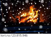 Купить «close up of firewood burning in fireplace and snow», фото № 23815946, снято 16 октября 2015 г. (c) Syda Productions / Фотобанк Лори