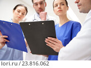Купить «close up of doctors with clipboard at hospital», фото № 23816062, снято 3 декабря 2015 г. (c) Syda Productions / Фотобанк Лори