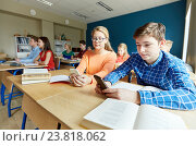 Купить «students with smartphone texting at school», фото № 23818062, снято 22 апреля 2016 г. (c) Syda Productions / Фотобанк Лори