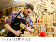 Купить «carpenter with wood, hammer and chisel at workshop», фото № 23818082, снято 14 мая 2016 г. (c) Syda Productions / Фотобанк Лори