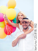 couple with colorful balloons at seaside. Стоковое фото, фотограф Syda Productions / Фотобанк Лори
