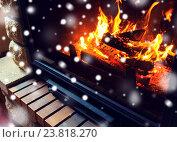 Купить «close up of burning fireplace with snow», фото № 23818270, снято 16 октября 2015 г. (c) Syda Productions / Фотобанк Лори