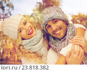 Купить «happy couple in warm clothes over autumn», фото № 23818382, снято 7 октября 2012 г. (c) Syda Productions / Фотобанк Лори