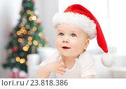 Купить «baby boy in christmas santa hat over blue lights», фото № 23818386, снято 22 мая 2014 г. (c) Syda Productions / Фотобанк Лори