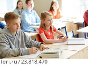 Купить «group of students with notebooks at school lesson», фото № 23818470, снято 22 апреля 2016 г. (c) Syda Productions / Фотобанк Лори