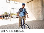 Купить «young hipster man with bag riding fixed gear bike», фото № 23818526, снято 15 июня 2016 г. (c) Syda Productions / Фотобанк Лори