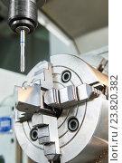 Купить «thread or screw cutting process on cnc machine by tap», фото № 23820382, снято 14 октября 2016 г. (c) Дмитрий Калиновский / Фотобанк Лори