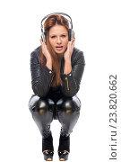 Купить «stylish girl in black leather dress with headphones on a white background», фото № 23820662, снято 13 февраля 2016 г. (c) Константин Лабунский / Фотобанк Лори