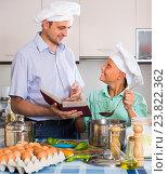 Купить «Father and teenage son cooking together», фото № 23822362, снято 20 ноября 2019 г. (c) Яков Филимонов / Фотобанк Лори