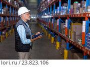 Купить «Warehouse worker checking the inventory», фото № 23823106, снято 23 марта 2016 г. (c) Wavebreak Media / Фотобанк Лори