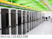 Купить «Hallway with a row of servers», фото № 23823330, снято 13 апреля 2016 г. (c) Wavebreak Media / Фотобанк Лори