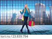 Купить «Woman with shopping bags in sale concept», фото № 23839794, снято 7 августа 2020 г. (c) Elnur / Фотобанк Лори