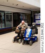Купить «Pensioner sitting on a mobility scooter», фото № 23844302, снято 7 июня 2020 г. (c) age Fotostock / Фотобанк Лори
