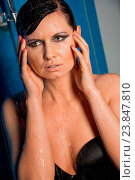 Купить «Beautiful wet brunette woman in sexy black lingerie standing dripping water with her hands raised to her head and a serious expression looking to the right side of the frame, high angle view», фото № 23847810, снято 3 апреля 2013 г. (c) easy Fotostock / Фотобанк Лори