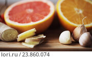 Купить «ginger, grapefruit, orange and garlic on board», видеоролик № 23860074, снято 18 октября 2016 г. (c) Syda Productions / Фотобанк Лори