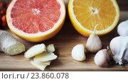 Купить «ginger, grapefruit, orange and garlic on board», видеоролик № 23860078, снято 18 октября 2016 г. (c) Syda Productions / Фотобанк Лори
