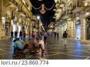 Купить «Торговая пешеходная улица Низами с яркой ночной подсветкой в центре Баку. Азербайджан», фото № 23860774, снято 22 сентября 2016 г. (c) Евгений Ткачёв / Фотобанк Лори