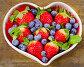 Berries in heart shaped bowl., фото № 23886242, снято 19 апреля 2016 г. (c) Tatjana Baibakova / Фотобанк Лори