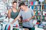 girl and boy teenagers in book store, фото № 23901442, снято 16 сентября 2016 г. (c) Яков Филимонов / Фотобанк Лори