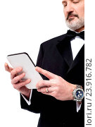 Купить «Mature businessman looking at his digital tablet», фото № 23916782, снято 13 ноября 2014 г. (c) easy Fotostock / Фотобанк Лори