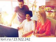 Купить «happy creative team with computer in office», фото № 23922242, снято 29 марта 2015 г. (c) Syda Productions / Фотобанк Лори