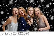 Купить «happy young women with microphone singing karaoke», фото № 23922590, снято 21 ноября 2015 г. (c) Syda Productions / Фотобанк Лори