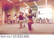 Купить «young man and woman training with barbell in gym», фото № 23922666, снято 30 ноября 2014 г. (c) Syda Productions / Фотобанк Лори