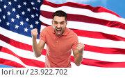 Купить «angry man showing fists over american flag», фото № 23922702, снято 15 января 2016 г. (c) Syda Productions / Фотобанк Лори