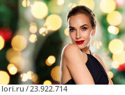 Купить «beautiful woman in black over dark background», фото № 23922714, снято 14 апреля 2016 г. (c) Syda Productions / Фотобанк Лори