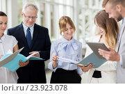 Купить «business team with tablet pc and folders at office», фото № 23923078, снято 3 июля 2016 г. (c) Syda Productions / Фотобанк Лори