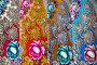 Знаменитые платки Павловопосадской платочной мануфактуры с традиционным узором - розой, в ассортименте в фирменном магазине в Павловском Посаде, Россия, фото № 23957982, снято 26 октября 2016 г. (c) Николай Винокуров / Фотобанк Лори