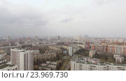 Купить «Aerial view of one of the districts of Moscow. Moscow state University and Moscow city in the distance. Urban cityscape», видеоролик № 23969730, снято 26 августа 2016 г. (c) Данил Руденко / Фотобанк Лори