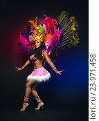 Купить «Симпатичная молодая девушка в ярком красочном карнавальном костюме на темном фоне», фото № 23971458, снято 24 января 2015 г. (c) Евгений Захаров / Фотобанк Лори