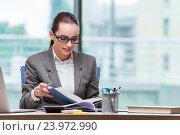 Купить «Businesswoman sitting at her desk in business concept», фото № 23972990, снято 15 августа 2016 г. (c) Elnur / Фотобанк Лори